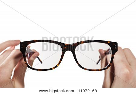 Glasses With Horn-rimmed In Human Hands