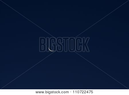 Wane moon in blue sky background