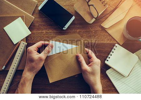 Opening Envelope.