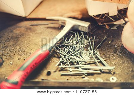 Construction Tools, Carpentry Hammer And Nails In Work Shop. Soft Effect On Photo