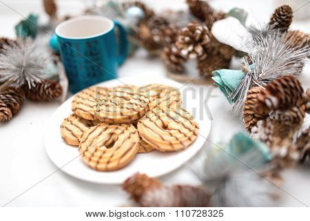 Chocolate And Caramel Cookies With Christmas Decorations Isolated