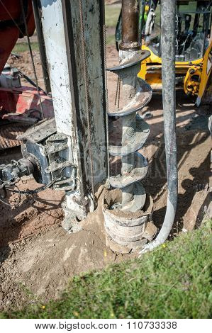 Close Up Of Construction Auger, Industrial Drilling Rig Making A hole in the ground