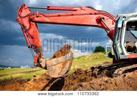 Eathmover, Industrial Digger And Excavator Working In Sandpit On construction site
