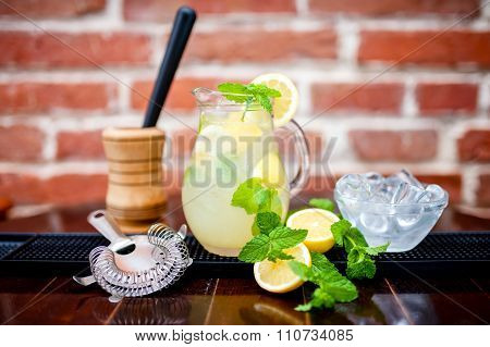 Fresh, Iced Mint Lemonade In A Jug With Sliced Lemon, Mint and ice