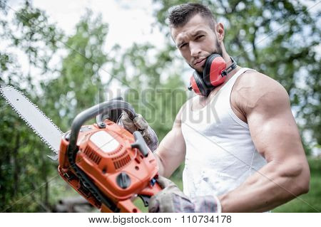 Portrait Of Aggressive Muscular Male Lumberjack, Woodworker With