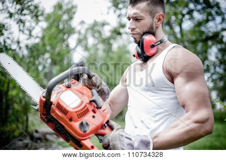 Portrait Of Angry Muscular Male Lumberjack, Woodworker With Chai