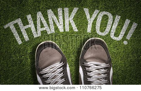 Top View of Sneakers on the grass with the text: Thank You