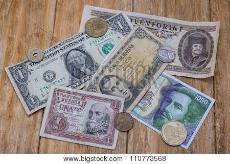Bills And Coins Of Spanish Pesetas, Dollar And Hungarian Forint