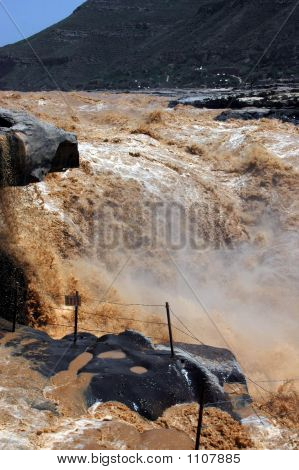 hukou waterfall is situated in jixian country shanxi province china.this scenic spot has a total area of 100sqkm and is composed of four main kinds of earth's surfaces and land form i.e.the loess plateau yellow river yellow river gorge and waterfall  poster