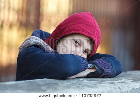 dramatic portrait of a little homeless boy poverty city street poster