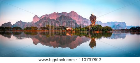 Amazing Buddhist Kyauk Kalap Pagoda under evening sky. Hpa-An Myanmar (Burma) travel landscapes and destinations. Four images panorama poster