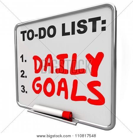 Daily Goals words written with red marker or pen on a to do list message board to prioritize jobs, tasks and work