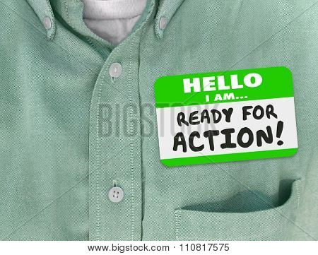 Hello I Am Ready for Action words written on green nametag sticker on a shirt of an employee or worker