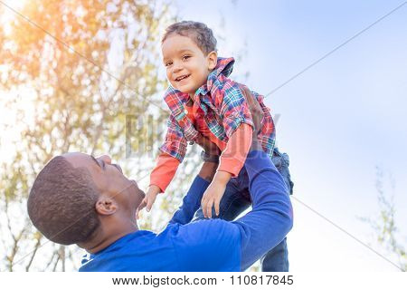 Cute father and son playing together at the park