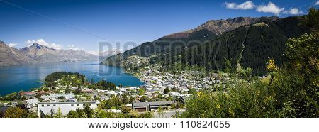 Sunny Panoramic View Of Queenstown On New Zealand's South Island