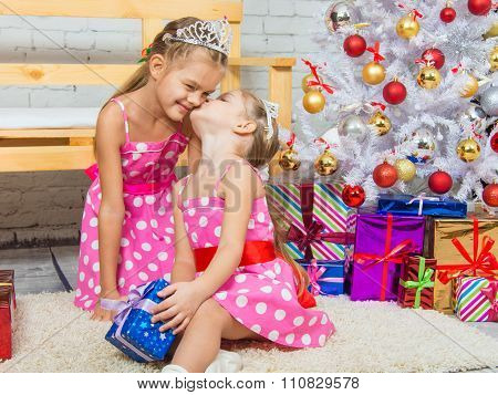 Girl Kissing Her Sister Because She Gave Her A Gift