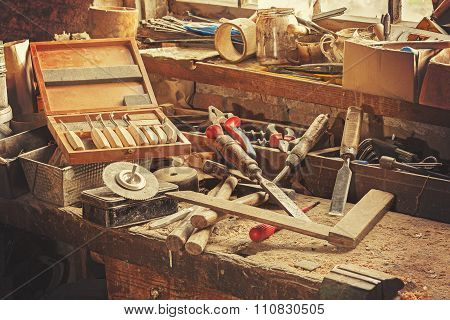 Retro Stylized Old Tools On Wooden Table In A Joinery