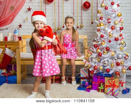 Girl Dressed As Santa Claus Brought Gifts In The Bag, Another Girl Rejoices