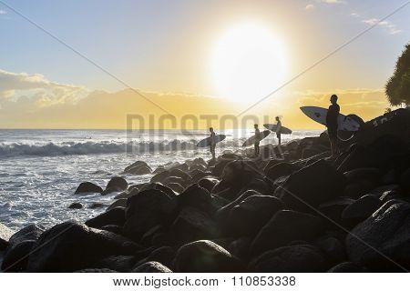 Sunrise surfer's silhouette's