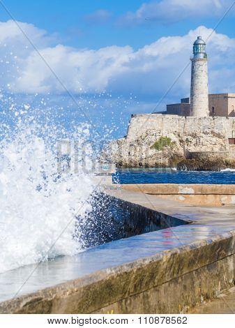 El Morro castle in Havana with sea waves crashing on the Malecon seawall