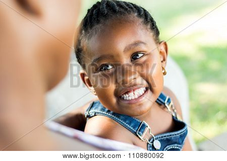 Face Shot Of African Girl Laughing.