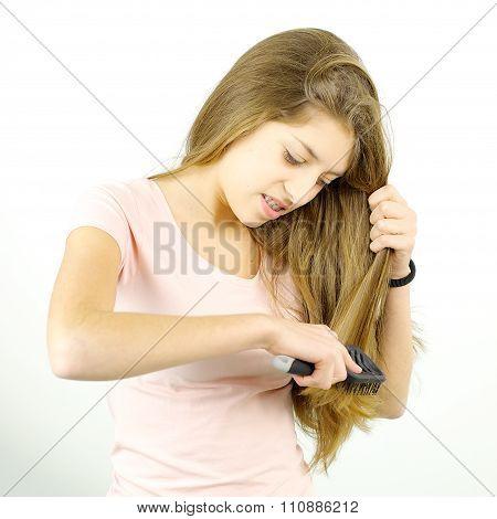 Cute Girl Having Trouble Brushing Tangled Long Hair
