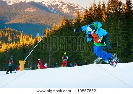 Snowboarder Jumping At Ski Resort