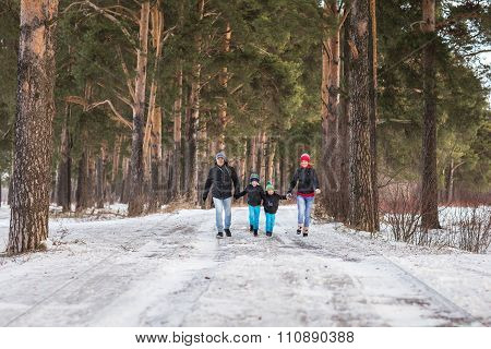 Happy Family In The Winter Forest.