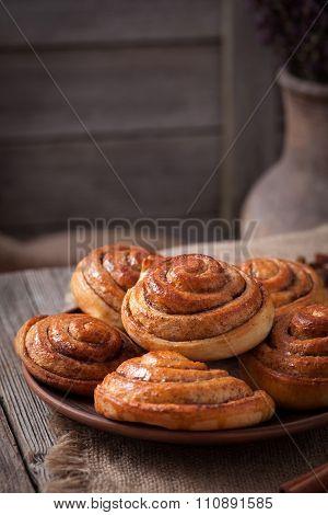 Sweet cinnamon bun rolls christmas scandinavian delicious sweet dessert on vintage woonde table. Traditional swedish kanelbullar baked pastry poster