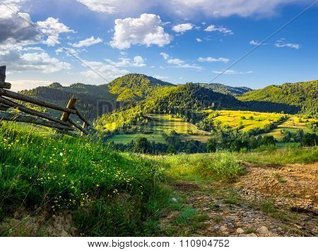 Wooden Fence In The Grass On The Hillside