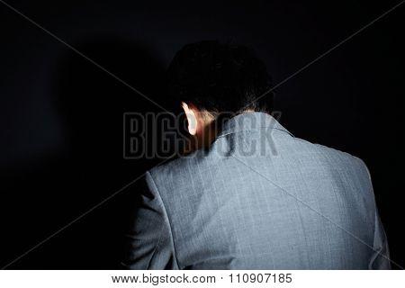 Sad worker isolated on black