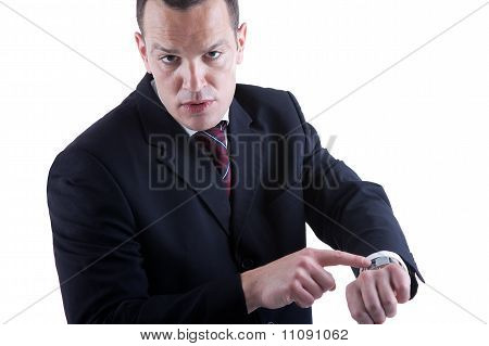Businessman Pointing To The Watch, Isolated On White Background. Studio Shot.