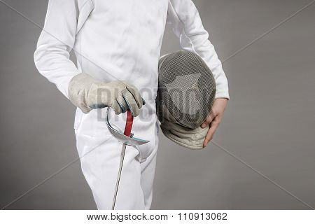 Cropped image of a foil fencer on gray background with space for your text.