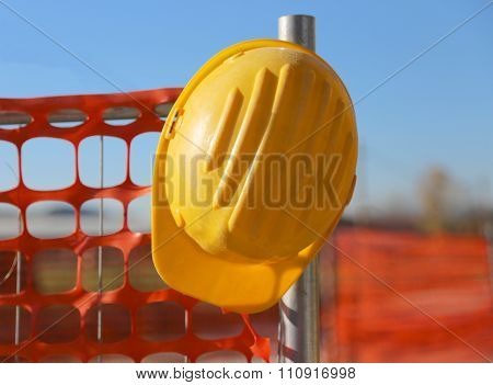 Hard Hat On The Road Construction Site During Road Works And A Safety Net