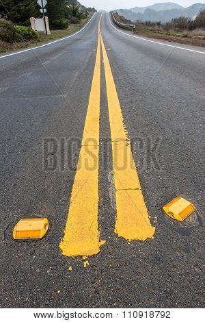 Road With Double Yellow Lines And Reflectors