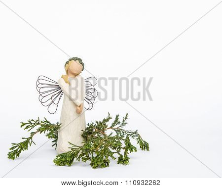 Faceless Angel Ornament with Evergreens