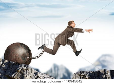 Man hopping over bottomless pit