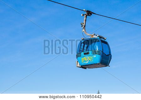 Close up Bansko cable car cabin against blue sky, Bulgaria