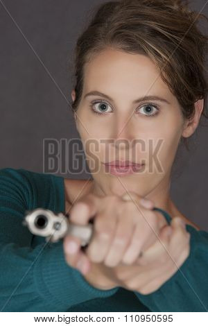 Caucasian Woman Defending Herself Using A Handgun