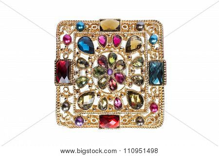 Golden brooch with gemstones isolated over white poster