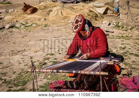Quechua Woman Working In A Village In The Andes, Ollantaytambo, Peru