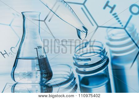 Science laboratory test tubes, chemical flask and a pipet with drop, laboratory equipment closeup