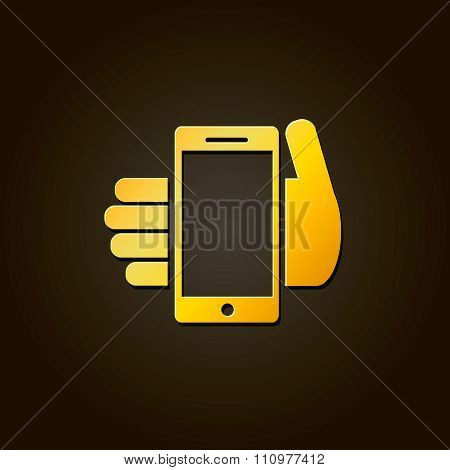 Mobile phone in hand - gold vector icon or logo