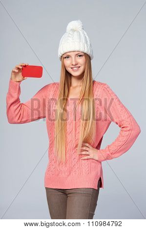 Woman wearing woolen hat and sweater