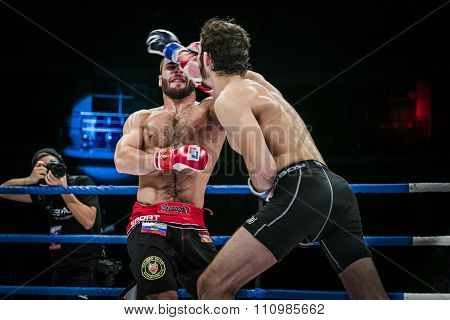 athlete mixed martial arts gets strong jab hand to his opponent