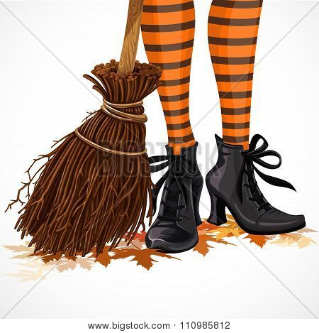 Halloween Closeup Witch Legs In Boots And With Broomstick Standi