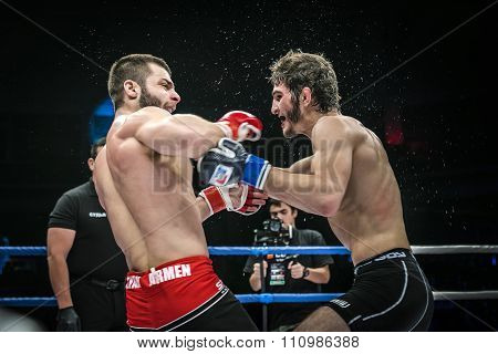 final fight of MMA fighters. splashing water and sweat