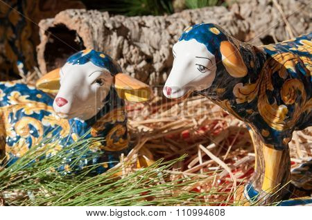 Painted pottery statue portraying a sheep in a ceramic nativity scene of an artisan in Caltagirone poster
