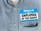 Employee of the Month words written on a nametag worn by a worker or top staff member in a blue shirt poster