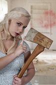 Beautiful possessed woman in a trance holding an axe poster